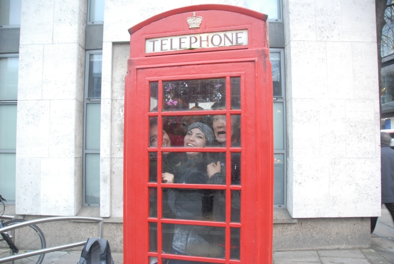 4-5 people inside a telephone booth outside St. Paul's