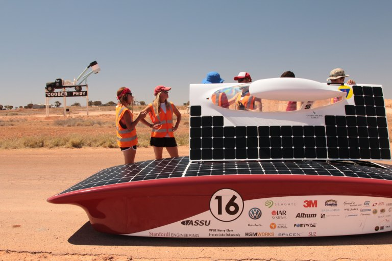 the truck on a pole and the solar car
