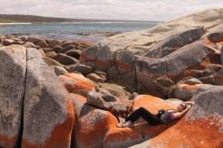 relaxing on a hammock-shaped rock