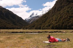 Reading by the Routeburn Flats Hut